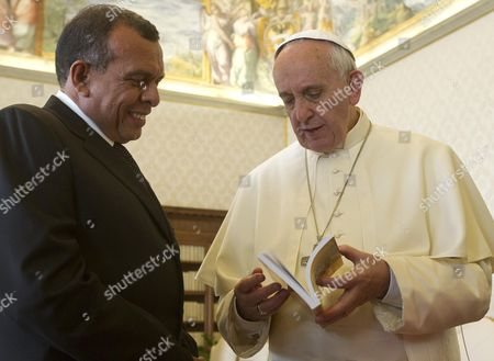 Pope Francis (r) and Honduras' President Porfirio Lobo Sosa Exhange Gifts As the Pontiff Receives His Guest and His Delegation in Private Audience at His Rooms at the Vatican Vatican City 20 September 2013 Man in Center is not Identified Vatican City State (holy See) Vatican City