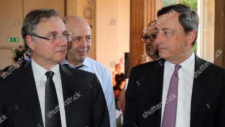 Mario Draghi (r) the President of the European Central Bank (ecb) Ignazio Visco (l) the Governor of the 'Banca D'italia' and Raffaele Jerusalmi (2-l) Ceo of the Italian Stock Exchange 'Borsa Italiana' Attend the T2s (target2-securities) Launch in Milan Italy 02 July 2015 the T2s Platform of the European Central Bank (ecb) According to Media Reports is a Mechanism Designed to Settle Securities and Exchanging the Legal Ownership in a Transaction's Final Phase Italy Milan