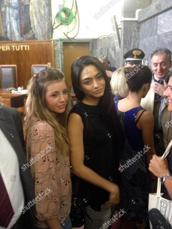 Ambra Battilana (r) and Chiara Danese Two Former Regional Beauty Queens and Witnesses in the Case Wait in a Milan Courthouse 19 July 2013 to Hear the Judge's Sentencing in the Trial of Three Associated of Former Italian Premier Silvio Berlusconi Emilio Fede Lele Mora and Nicole Minetti Found Guilty of Procuring Prostitutes For the Media Magnate's Controversial and So-called ' Bunga Bunga' Parties They Were Given Jail Sentences of Between Five and Seven Years Italy Milan