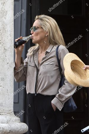 Us Actress/cast Member Sharon Stone Drinks a Beverage During the Filming of the Movie 'Il Ragazzo D'oro' (lit : the Golden Boy) at the Piazza Del Popolo in Rome Italy 18 July 2013 on the First Day of Shooting of the New Movie of Italian Director Pupi Avati Italy Rome