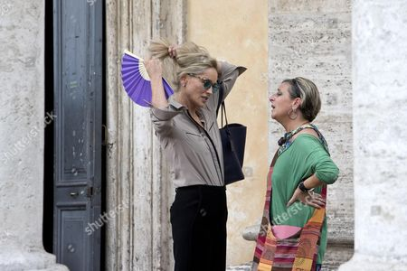 Us Actress/cast Member Sharon Stone (l) Chats with an Identified Woman As She Gets Ready to Shoot a Scene During the Filming of the Movie 'Il Ragazzo D'oro' (lit : the Golden Boy) at the Piazza Del Popolo in Rome Italy 18 July 2013 on the First Day of Shooting of the New Movie of Italian Director Pupi Avati Italy Rome