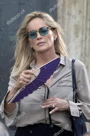 Us Actress/cast Member Sharon Stone Gets Ready to Shoot a Scene During the Filming of the Movie 'Il Ragazzo D'oro' (lit : the Golden Boy) at the Piazza Del Popolo in Rome Italy 18 July 2013 on the First Day of Shooting of the New Movie of Italian Director Pupi Avati Italy Rome
