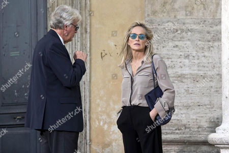 Us Actress/cast Member Sharon Stone (r) Performs a Scene During the Shooting of the Movie 'Il Ragazzo D'oro' (lit : the Golden Boy) at the Piazza Del Popolo in Rome Italy 18 July 2013 the Filming of the New Movie of Italian Director Pupi Avati Started the Same Day Italy Rome