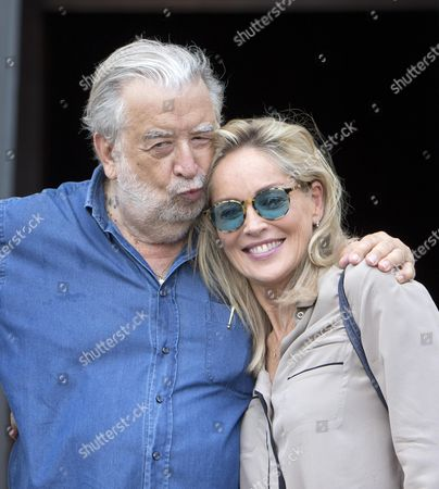 Italian Director Pupi Avati (l) Hugs Us Actress/cast Member Sharon Stone During the Shooting of the Movie 'Il Ragazzo D'oro' (lit : the Golden Boy) at the Piazza Del Popolo in Rome Italy 18 July 2013 the Filming of the Avati's New Movie Started the Same Day Italy Rome