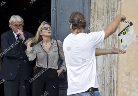 Us Actress/cast Member Sharon Stone (c) Gets Ready to Perform a Scene During the Shooting of the Movie 'Il Ragazzo D'oro' (lit : the Golden Boy) at the Piazza Del Popolo in Rome Italy 18 July 2013 the Filming of the New Movie of Italian Director Pupi Avati Started the Same Day Italy Rome