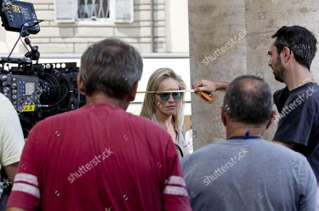 Us Actress/cast Member Sharon Stone (c) Waits to Perform a Scene During the Shooting of the Movie 'Il Ragazzo D'oro' (lit : the Golden Boy) at the Piazza Del Popolo in Rome Italy 18 July 2013 the Filming of the New Movie of Italian Director Pupi Avati Started the Same Day Italy Rome