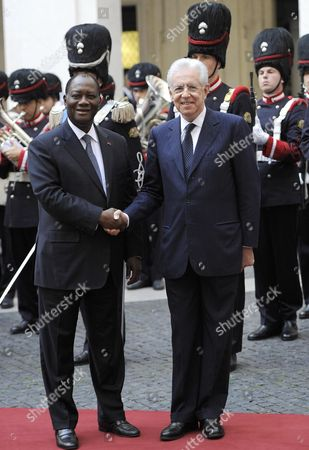 Italian Premier Mario Monti (r) Shakes Hands with President of Costa D'avorio Alassane Dramane Ouattara (l) As They Pose For Photographs During an Official Visit at the Palazzo Chigi Rome Italy 16 November 2012 Italy Rome