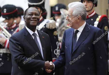 Italian Premier Mario Monti (r) Shakes Hands with President of Costa D'avorio Alassane Dramane Ouattara (l) During an Official Visit at the Palazzo Chigi Rome Italy 16 November 2012 Italy Rome