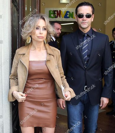 Marina Berlusconi Daughter of Former Italian Prime Minister Silvio Berlusconi and Her Husband Maurizio Vanadia (r) Leave the Polling Station After the Vote in Milan Italy 25 May 2014 the European Elections Will Form a New European Parliament Whose 751 Members Will Help Set Laws in the European Union For Five Years to Come About 400 Million People in the 28-country Bloc Are Eligible to Vote Italy Milan