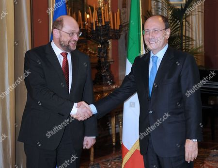 Italian Senate President Mario Schifani (r) Shakes Hands with European Parliament President Martin Schulz (l) During Their Meeting at Giustiniani Palace Rome Italy 23 February 2012 Ep-president Martin Schulz is on an Official Visit to Italy with Meetings with Italian President Giorgio Napolitano Prime Minister Mario Monti Parliament Speaker Gianfranco Fini and Senate Speaker Renato Schifani President Schulz Will Also Attend a Ceremony in Bologna City Hall to Commemorate the Marzabotto Massacre and Visit the Monte Sole Memorial There in Honour of the Hundreds of Victims of Waffen Ss Reprisals During World War Ii Italia Roma