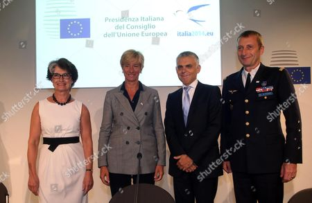 Stock Photo of (l-r) President of European Defence Agency (eda) Claude France Arnould Italian Defense Minister Roberta Pinotti Polish Ambassador and Deputy Secretary General For the External Action Service (eas) Maciej Popowski and Chairman of the European Union Military Committee (ceumc) General Patrick De Rousiers Pose at the End of the Press Conference in Milan Italy 10 September 2014 European Defense Ministries Met in Milan to Display European Antiterrorism Action Italy Milan