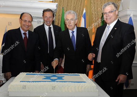 Italian Prime Minister Mario Monti (2-r) is Flanked by Israeli Ambassador to Italy Naor Gilon (r) the President of the Chamber of Deputies Gianfranco Fini (2-l) and Senate President Renato Schifani (l) As They Pose Cutting a Cake at Vialla Miani During a Ceremony to Mark Israel's Independence Day in Rome Italy 03 May 2012 the Israeli Independence Day Which was Celebrated on 26 April 2012 in Israel Marked the 64th Anniversary of the Creation of the Jewish State in 1948 Italy Rome