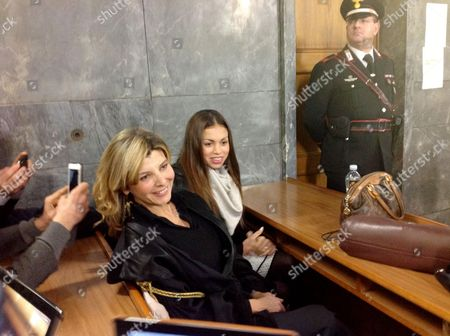 Stock Image of A Photo Made Available 17 January 2013 Shows Moroccan-born Karima El-mahroug (c) Also Known As Ruby Rubacuori (ruby Heart Stealer) and Her Lawyer Paola Baccardi (l) As They Pose For Photographers Inside the Courtroom Prior to Ruby's Testimony As Defense Witness in the Trial of Former Italian Prime Minister Silvio Berlusconi in Milan Italy 14 January 2013 20-year-old Ruby Had Been Fined After Twice Failing to Appear in Court in December and Vacationing with Her Boyfriend Instead Berlusconi is Accused of Having Had Sex with Her when She was 17 During Socalled 'Bunga Bunga' Parties at His Villa Outside Milan and Pressuring Police to Release Her After She Had Been Held on Suspicion of Theft Both Deny Having Had a Sexual Relationship Italy Milan