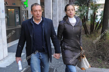 Karima El Mahroug Also Known As Ruby Rubacuori and Partner Luca Risso Hold Hands While Leaving the Court in Genoa Italy on 09 March 2012 the Boyfriend of a Morroccan Go-go Dancer at the Centre of a Sex Scandal Involving Former Premier Silvio Berlusconi Has Been Ordered to Stand Trial on Underage Pornography Charges Italian Media Reported Friday the Charges Against Luca Risso Stem From October 2010 when the Dancer Karima El Mahroug Then 17 Years Old Allegedly Appeared in a Pornographic Performance in a Genoa Nightclub Owned by Risso Genoa Magistrate Massimo Cusatti Set the First Hearing in the Trial For April 11 the Ansa News Agency Reported Italy Genoa