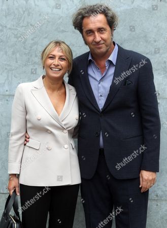 Stock Photo of Italian Film Director Paolo Sorrentino and His Wife Daniela D' Antonio Poses While Visiting the Presentation of the Spring/summer 2015 Collection by Italian Designer Giorgio Armani During the Milan Fashion Week in Milan Italy 20 September 2014 the Milano Moda Donna Runs From 17 to 22 September Italy Milan