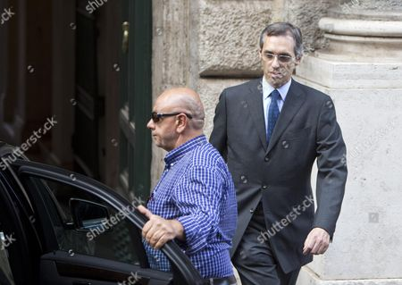 The Senator of Party of the Freedom and Berlusconi's Lawyer Niccolo Ghedini (r) Leaves the Palazzo Grazioli After a Summit with Berlusconi at the Latter's Residence in Rome 01 October 2013 a Senate Committee Will Vote Later This Week Whether to Expel Berlusoni Following His Recent Conviction on Tax Fraud Italy Rome