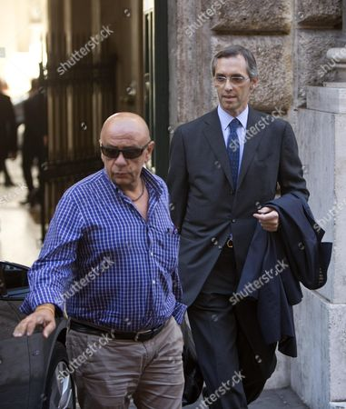 The Senator of Party of the Freedom and Silvio Berlusconi's Lawyer Niccolo Ghedini (r) Leaves the Palazzo Grazioli After a Summit with Berlusconi at the Latter's Residence in Rome 1 October 2013 a Senate Committee Will Vote Later This Week Whether to Expel Berlusoni Following His Recent Conviction on Tax Fraud Italy Rome