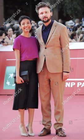 Stock Image of Belgium Director Gust Van Den Berghe (r) and Producer Natalia Trevino (l) Arrive For the Premiere of the Movie 'Lucifer' at the 9th Annual Rome Film Festival in Rome Italy 19 October 2014 the Festival Runs From 16 to 25 October Italy Rome