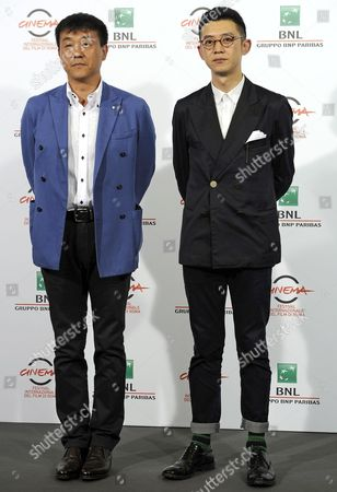 Chinese Actor He Bing (l) and Compatriot Director Xu Ang (r) Pose During the Photocall For the Movie '12 Citizens' (shier Gongmin) at the 9th Annual Rome Film Festival in Rome Italy 19 October 2014 the Festival Runs From 16 to 25 October Italy Rome