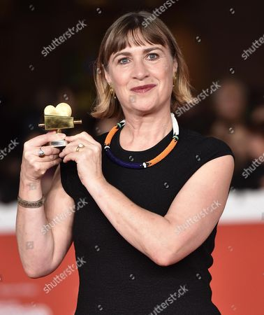 British Producer Laura Hastings-smith Shows the 'Alice Nella Citta' Award For the Movie 'X+y' at the Closing Ceremony of the 9th Annual Rome Film Festival in Rome Italy 25 October 2014 the Festival Runs From 16 to 25 October Italy Rome