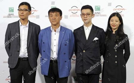 Chinese (l-r) Screenwriter Han Jinglong Actor He Bing Director Xu Ang and Producer Wang Luna Pose During the Photocall For the Movie '12 Citizens' (shier Gongmin) at the 9th Annual Rome Film Festival in Rome Italy 19 October 2014 the Festival Runs From 16 to 25 October Italy Rome