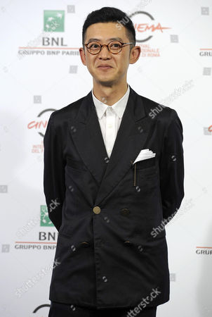 Chinese Director Xu Ang Poses During the Photocall For the Movie '12 Citizens' (shier Gongmin) at the 9th Annual Rome Film Festival in Rome Italy 19 October 2014 the Festival Runs From 16 to 25 October Italy Rome