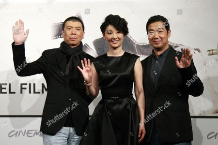 Stock Picture of Chinese Director Feng Xiaogang (l) Poses with Chinese Actors Xu Fan (c) and Zhang Guoliat (r) During a Photocall For the Movie '1942' (back to 1942) at the 7th Annual Rome Film Festival in Rome Italy 11 November 2012 the Movie is Presented in the Official Competition of the Festival That Runs From 09 to 17 November Italy Rome