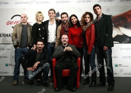 Stock Picture of Italian Director Carlo Lucarelli (fronr C) Poses with Cast Members (l-r) Rolando Ravello Sara Sartini Gaetano Bruno Daniele Monterosi Irma Carolina Di Monte Veronica Gentili and Giampaolo Morelli During a Photocall For the Movie 'L'isola Dell'angelo Caduto' at the 7th Annual Rome Film Festival in Rome Italy 11 November 2012 the Movie is Presented in the 'Prospettive Italia' Selection of the Festival That Runs From 09 to 17 November Italy Rome