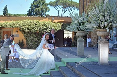 Dutch Princess Carolina (c) Arrives with Her Brother Carlos Duke of Parma (r) at San Miniato's Church For Her Wedding Ceremony in Florence Italy 16 June 2012 Dutch Princess Carolina is to Marry Albert Brenninkmeijer Italy Florence