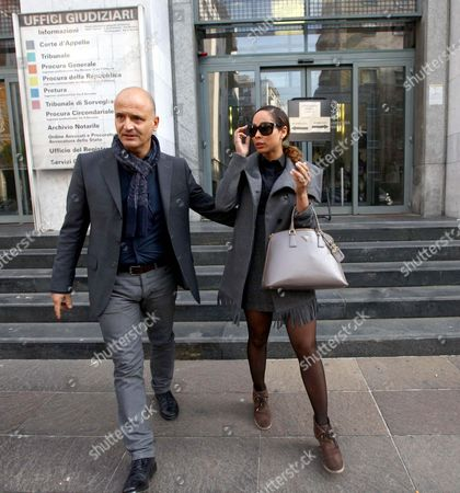 Aris Espinoza (r) Leaves a Court Building in Milan Italy 09 November 2012 Reports State That in the Trial Italian Former Prime Minister Silvio Berlusconi is Accused of Paying Moroccan Nightclub Dancer Karima El Mahroug Also Known by the Stage Name Ruby Rubacuori For Sexual Services Between February and May 2010 when She was Under the Age of 18 and For Abuse of Office Relating to Her Release From Detention Italy Milan