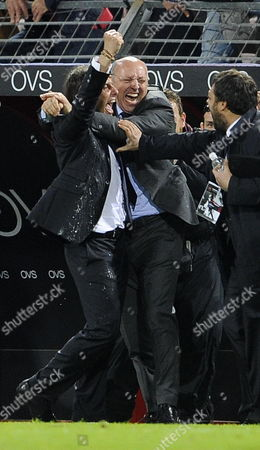 Italian Head Coach Antonio Conte (l) of Fc Juventus Embraces Ceo Beppe Marotta at the End of Italian Serie a Soccer Match Against Cagliari Calcio at Nereo Rocco Stadium in Trieste Italy 06 May 2012 Fc Juventus Have Won the Seria Season 2011-2012 Italy Trieste