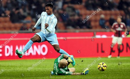 Milan's Goalkeeper Christian Abbiati (r) and Lazio's Keita (l) Vie For the Ball During Their Italy Cup Quarterfinal Soccer Match Ac Milan Vs Lazio Rome at the Giuseppe Meazza Stadium in Milan Italy 27 January 2015 Italy Milan