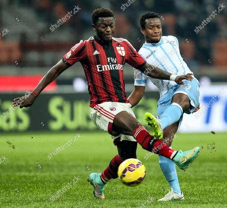 Milan's Sulley Muntari (l) and Lazio's Nigerian Ogenyi Onazi (r) Vie For the Ball During Their Italy Cup Quarterfinal Soccer Match Ac Milan Vs Lazio Rome at the Giuseppe Meazza Stadium in Milan Italy 27 January 2015 Italy Milan