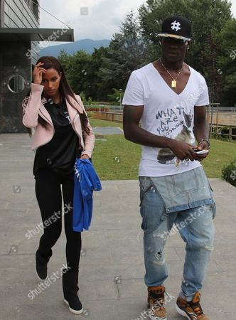Italian National Team Forward Mario Balotelli with His Girlfiend Fanny Neguesha Arrive in Brescia Italy 26 June 2014 the Italian National Team Arrived in Italy Today After Getting Knocked out in the First Round of Fifa World Cup 2014 in Brazil This Week Italy Brescia