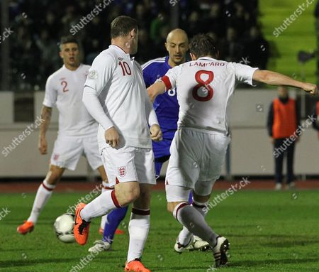 England's Midfielder Frank Lampard (r) Scores the Goal During the Fifa World Cup 2014 Qualification Soccer Match San Marino Vs England in San Marino 22 March 2013 San Marino San Marino