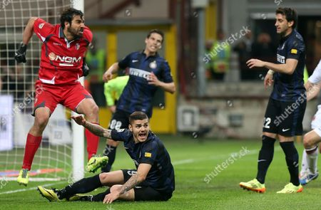 Bologna's Goalkeeper Gianluca Curci (l) Reacts After Saving a Penalty During the Italian Serie a Soccer Match Between Inter Milan and Bologna Fc at Giuseppe Meazza Stadium in Milan Italy 05 April 2014 Italy Milan