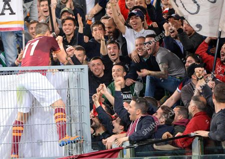 Roma's Rodrigo Taddei Celebrates with Supporters After Scoring the 4-1 Lead During the Italian Serie a Soccer Match Between As Roma and Parma Fc at Olimpico Stadium in Rome Italy 02 April 2014 Roma Won 4-2 Italy Rome