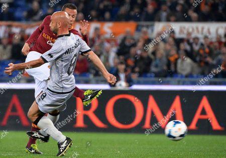 Rodrigo Taddei (back) of As Roma Scores the 1-0 Lead During the Italian Serie a Soccer Match Between As Roma and Atalanta Bergamo at the Olimpico Stadium in Rome Italy 12 April 2014 Italy Rome