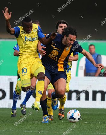 Stock Image of Chievo's Victor Obinna (l) in Action Against Hellas Verona's Luca Toni (r) During the Italian Serie a Soccer Match Between Ac Chievo Verona and Hellas Verona Fc at Bentegodi Stadium in Verona Italy 05 April 2014 Italy Verona