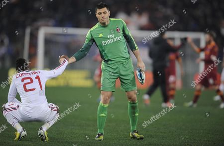Ac Milan's French Defender Kevin Constant (l) and Goalkeeper Marco Amelia at the End of the Italian Serie a Soccer Match As Roma Vs Ac Milan at the Olimpico Stadium in Rome Italy 22 December 2012 As Roma Won 4-2 Italy Rome
