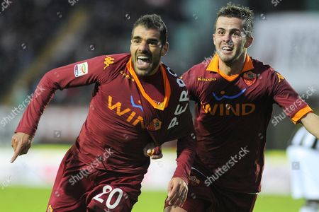 Player of As Roma Simone Perrotta (l) Celebrates After Scoring a Goal During Their Serie a Soccer Match at 'Artemio Franchi ' Montepaschi Arena in Siena Italy 02 December 2012 Italy Siena