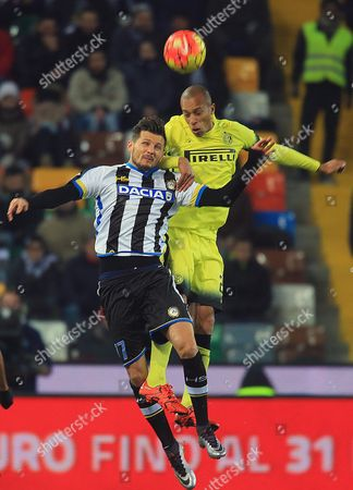 Stock Image of Udinese's Midfielder Cyril Thereau (l) in Action with Inter's Defender Joao De Souza Filho Miranda During the Italian Serie a Soccer Match Between Udinese Calcio and Fc Inter at Friuli Stadium in Udine Italy 12 December 2015 Italy Udine