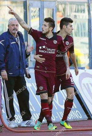 Livorno's Midfielder Leandro Greco (c) Celebrates with His Teammates After Scoring the Opening Goal During the Italian Serie a Soccer Match Between As Livorno and Us Sassuolo Calcio at Armando Picchi Stadium in Livorno Italy 26 January 2014 Italy Livorno
