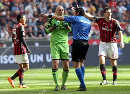 Ac Milan Goalkeeper Christian Abbiati Speaks with Referee Domenico Celli During the Italian Serie a Soocer Match Ac Milan Vs Parma Fc at the Giuseppe Meazza Stadium in Milan Italy 16 March 2014 Italy Milano