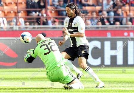 Ac Milan Goalkeeper Christian Abbiati Fouls Parma F C Midfielder Ezequiel Schelotto During the Italian Serie a Soocer Match Ac Milan Vs Parma Fc at the Giuseppe Meazza Stadium in Milan Italy 16 March 2014 Italy Milano