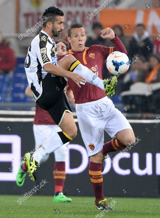 Rodrigo Taddei (r) of As Roma Vies For the Ball with Gimpiero Pinzi of Udinese Calcio During the Italian Serie a Soccer Match Between As Roma and Udinese Calcio at the Olympic Stadium in Rome Italy 17 March 2014 Italy Rome