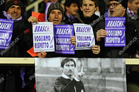 Fiorentina Supporters Hold Posters Reading 'Baschi We Want Respect' and Put It in Context with a Poster of Italian Actor Lando Buzzanca (bottom) As Carmelo Lo Cascio in the Film 'Playing the Field' (l'arbitro) During a Protest Against Recent Decisions by Referees Prior to Italian Serie a Soccer Match Fiorentina Vs Lazio at Artemio Franchi Stadium in Florence Italy 02 March 2014 Italy Florence