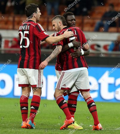 Ac Milan Forward Jeremy Menez (c) Celebrates with His Teammates Daniele Bonera (l) and Sulley Muntari After Scoring During the Italian Serie a Soccer Match Between Ac Milan and Hellas Verona at Giuseppe Meazza Stadium in Milan Italy 07 March 2015 Italy Milan