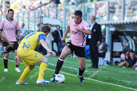 French's Chievo Nicolas Sebastien Frey (l) Fights For the Ball with Palermo's Igor Budan (r) During Their Serie a Match Palermo Vs Chievo at Renzo Barbera Stadium in Palermo Sicily Italy 06 May 2012 Italy Palermo