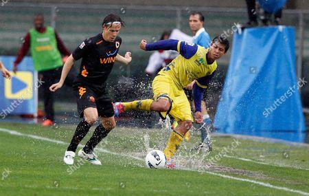 Rinaldo Cruzado (r) of Chievo and Rodrigo Taddei of Roma in Action During the Italian Serie a Soccer Match Between Ac Chievo Verona and As Roma at Bentegodi Stadium in Verona Italy 01 May 2012 Italy Verona